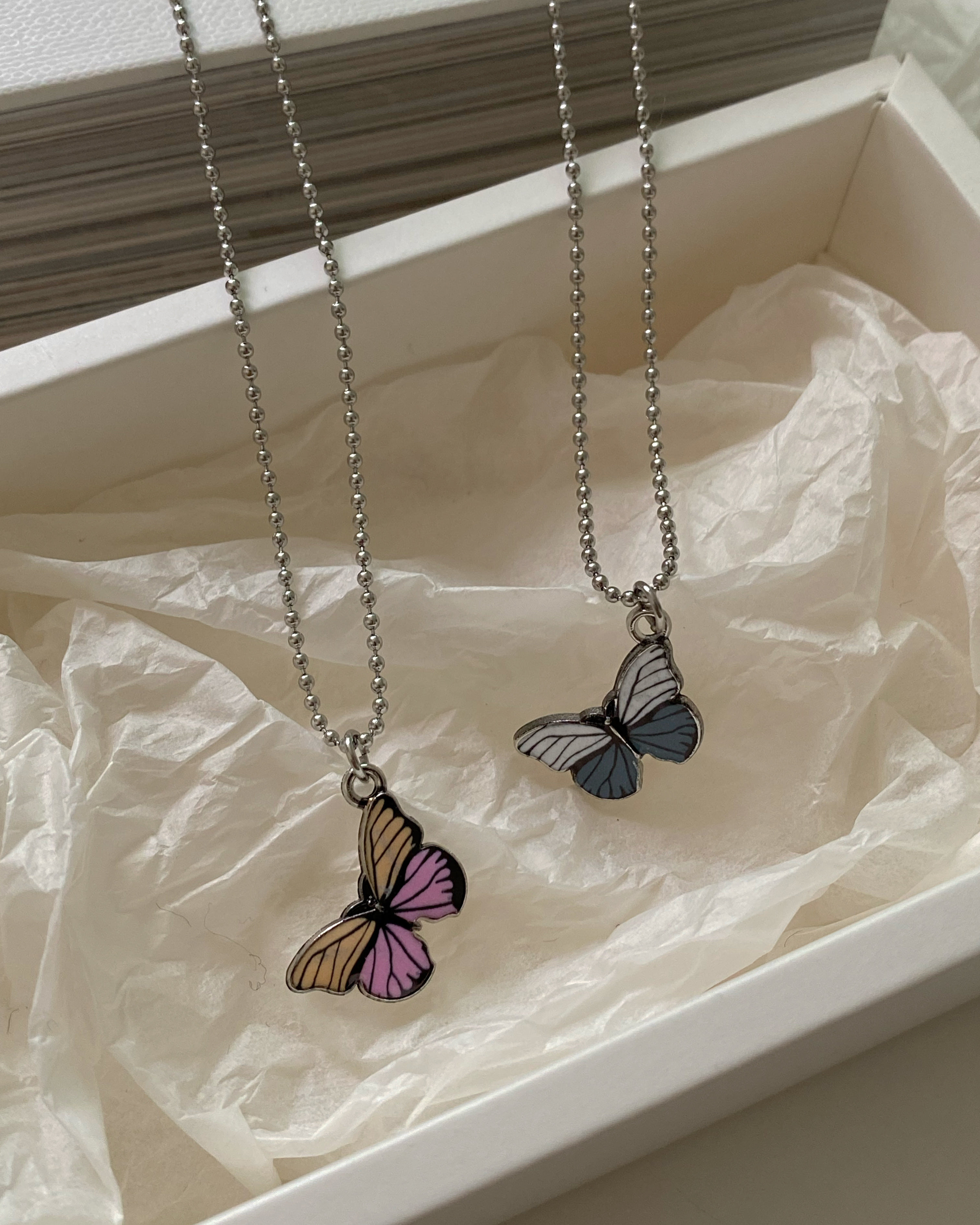 [써지컬스틸] gradation butterfly necklace (2 color)